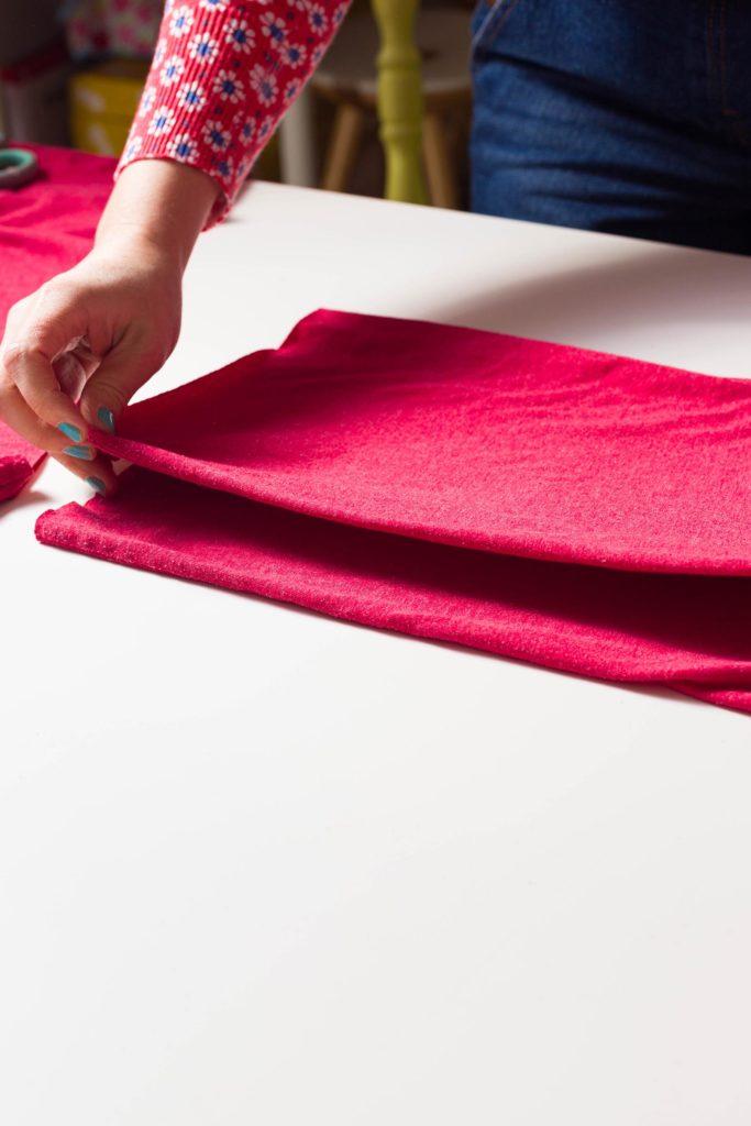 Folding over t-shirt to start cutting it